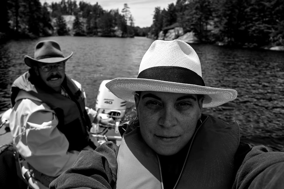 A photo of Julie and her Dad during a fishing trip